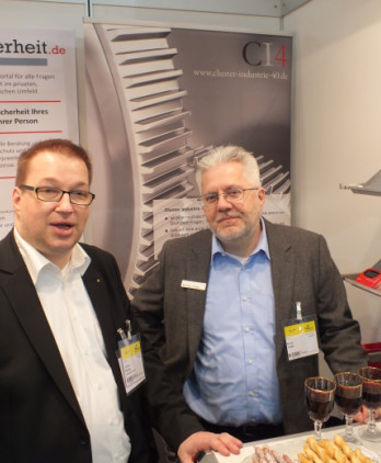 it-sa 2016: Carsten J. Pinnow und CI4-Sprecher Michael Taube bei der Begrüßung der Gäste am Stand